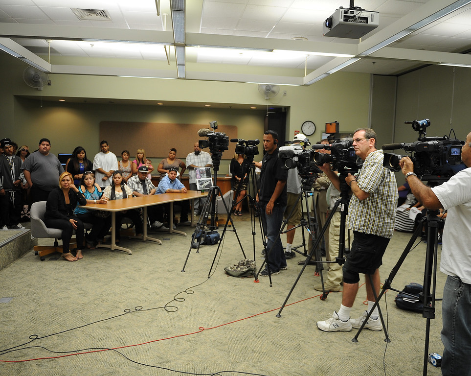. News media attend  a press conference at the San Bernardino County Sheriff\'s Headquarters Thursday August 22, 2013 in San Bernardino for Daniel Olivera 26, of Hesperia who was shot and killed at the AM/PM Arco convenience store on August 11, 2013 in Victorville.LaFonzo Carter/Staff Photograph