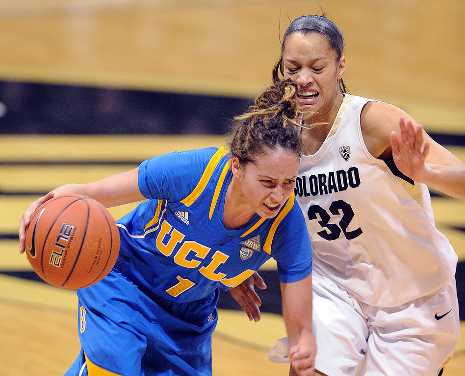 . UCLA\'s Thea Lemberger drives on Colorado\'s Arielle Roberson during the first half of an NCAA college basketball game Friday, Feb. 28, 2014, in Boulder, Colo. (AP Photo/Daily Camera, Cliff Grassmick)
