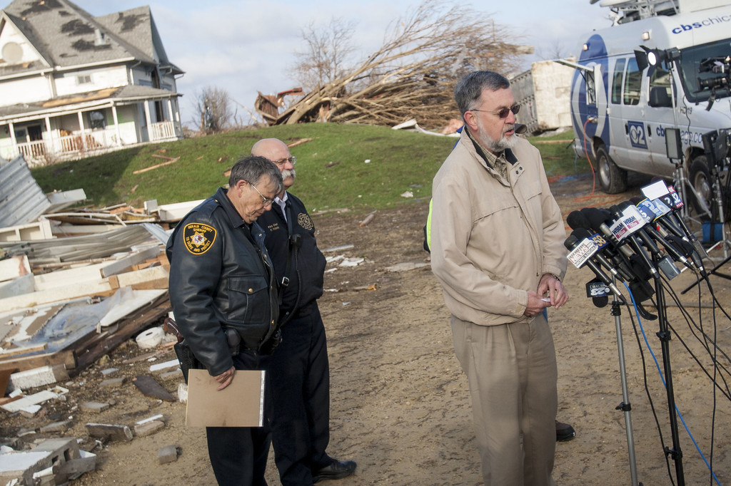. DeKalb County Coroner Dennis Miller addresses the media the morning after a tornado came through the town on April 10, 2015 in Fairdale, Illinois. According to reports, 11 people were injured and one person was killed when tornadoes and thunderstorms passed through the northwestern suburbs of Chicago. (Photo by Jon Durr/Getty Images)