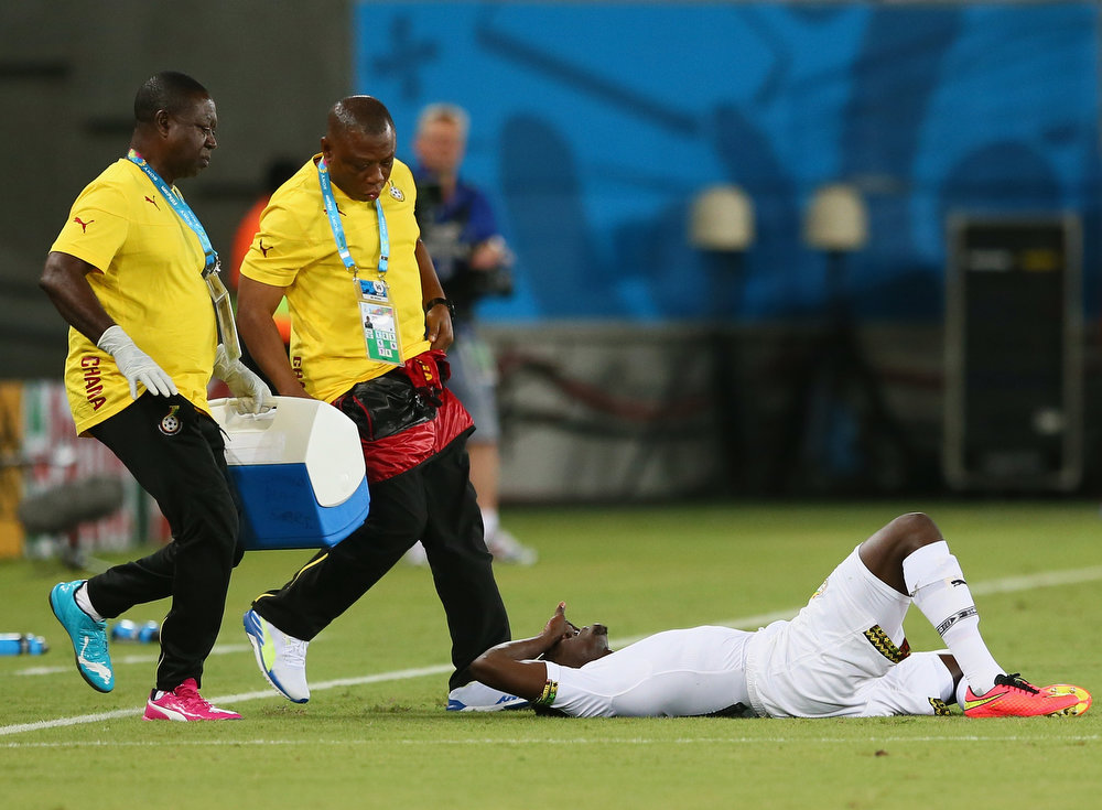 Description of . Daniel Opare of Ghana lies on the field after a challenge during the 2014 FIFA World Cup Brazil Group G match between Ghana and the United States at Estadio das Dunas on June 16, 2014 in Natal, Brazil.  (Photo by Kevin C. Cox/Getty Images)