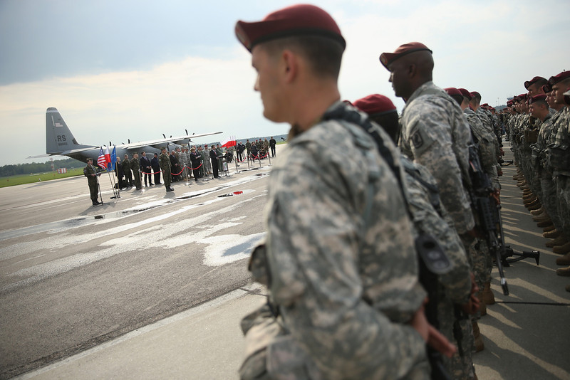 . Members of the U.S. Army 173rd Airborne Brigade attend a welcome ceremony upon their arrival by plane at a Polish air force base on April 23, 2014 in Swidwin, Poland. Approximately 150 U.S. troops, as well as another 450 destined for the three Baltic states in coming days, will participate in bilateral military exercises over the coming weeks in a sign of commitment among NATO members. Tensions are rising in eastern Ukraine between Russian separatists and Ukrainian authorities and NATO is seeking to reassure its own members located close to Russia.  (Photo by Sean Gallup/Getty Images)