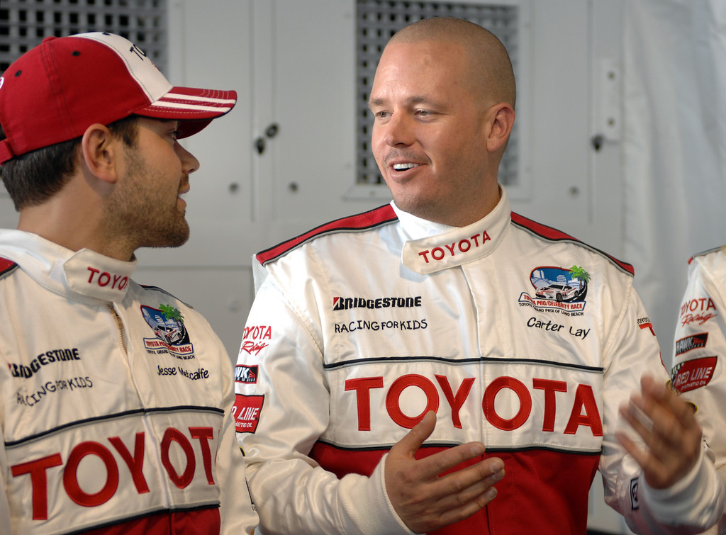 . 4/9/13 - Jesse Metcalfe and Carter Lay chat during media day for the 39th Annual Toyota Grand Prix of Long Beach. The celebrity/pro races spent the day practicing on the track, joking with their racing partners and giving interviews. Photo by Brittany Murray / Staff Photographer