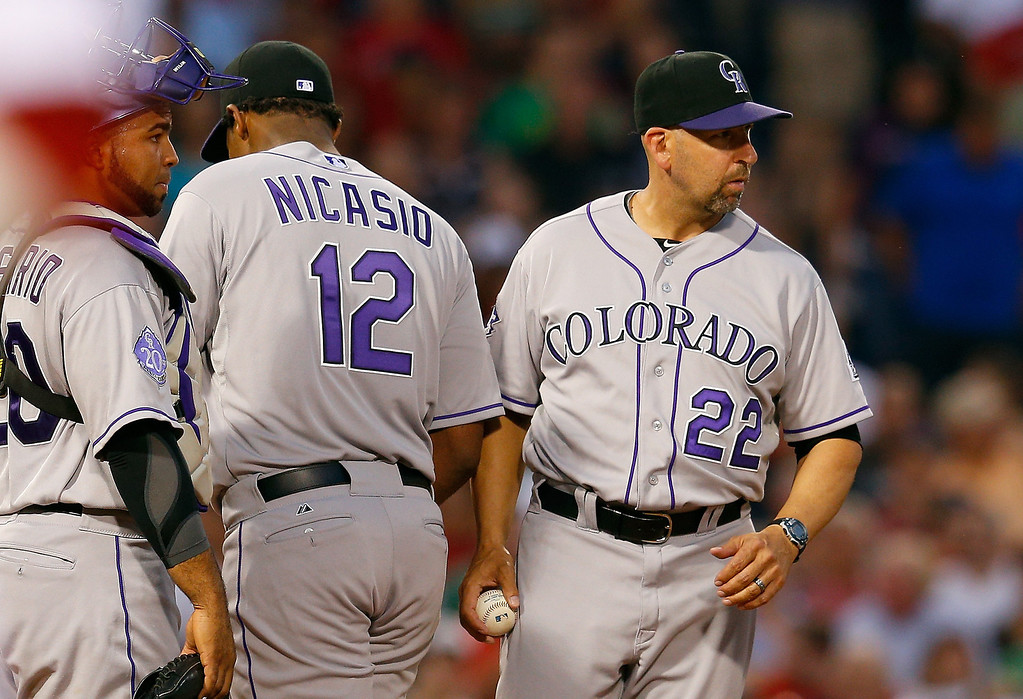 . Walt Weiss #22 of the Colorado Rockies removes Juan Nicasio #12 in the 3rd inning against the Boston Red Sox at Fenway Park on June 25, 2013 in Boston, Massachusetts.  (Photo by Jim Rogash/Getty Images)