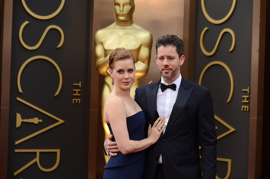 . Amy Adams, left, and Darren Le Gallo arrive at the Oscars on Sunday, March 2, 2014, at the Dolby Theatre in Los Angeles.  (Photo by Jordan Strauss/Invision/AP)