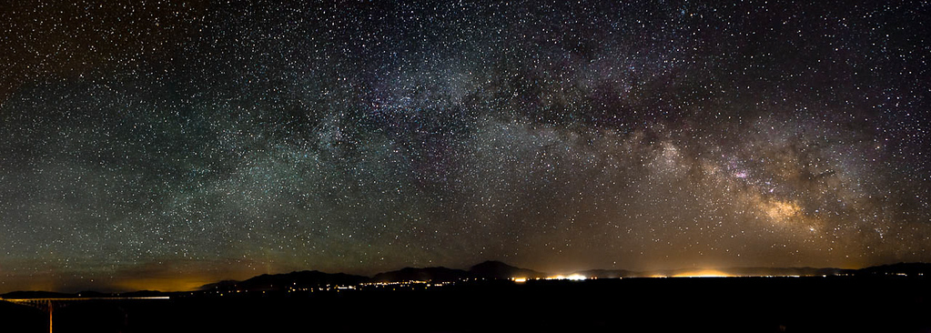 Panorama of the Milky Way over Taos NM and the Rio Grand River Gorge.  You can see the bridge off to the left. 24 images stitched together in  CS5.  Each image was 20 sec long, f/2.8 at 24mm ISO 3200, Canon 5DMrkII, 24-70mm L lens.