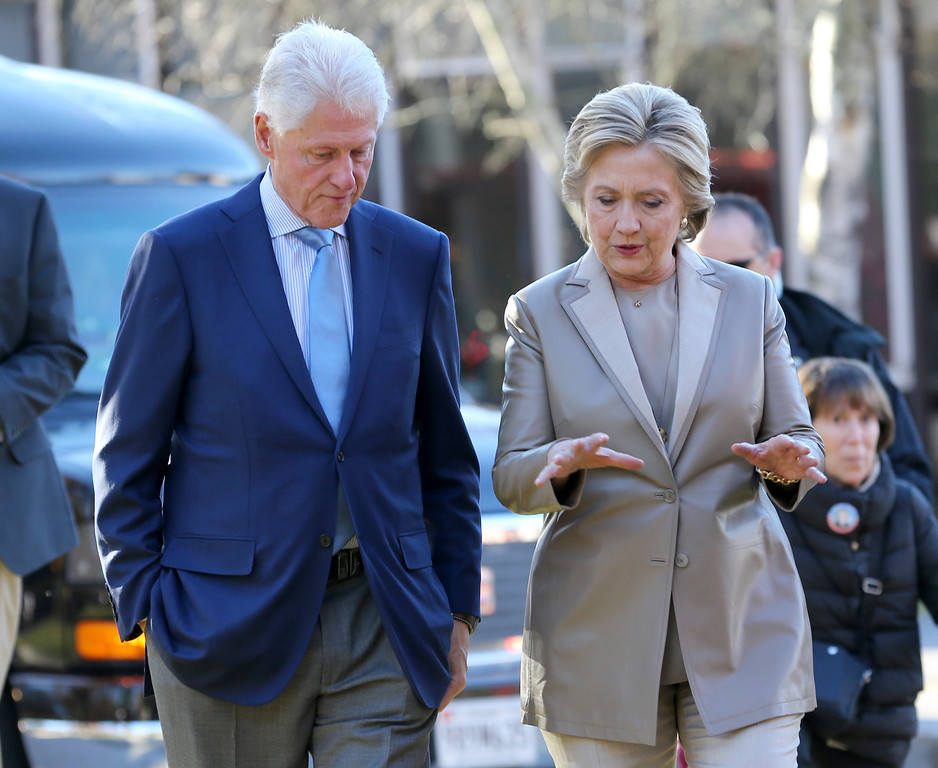 . Democratic presidential candidate Hillary Clinton and her husband former President Bill Clinton talk after voting in Chappaqua, N.Y., Tuesday, Nov. 8, 2016. (AP Photo/Seth Wenig)