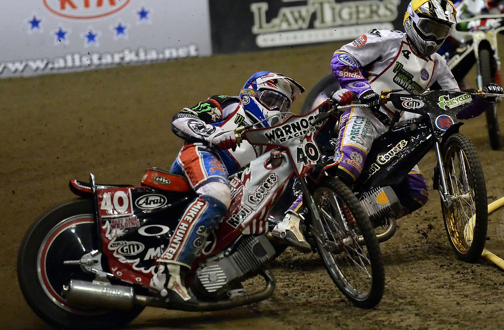 . Ryan Fisher leads in the first race race during the Monster Energy Speedway Cycles at the Industry Speedway in the Industry Hills Grand Arena in Industry, Calif., on Saturday, Dec. 28, 2013.     (Keith Birmingham Pasadena Star-News)