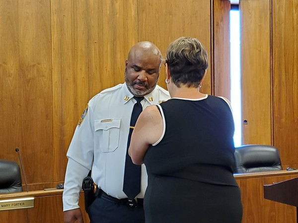 Justin Muszynski | Staff Stephen Tavares was promoted from lieutenant to captain of the Bristol Police Department during a ceremony Thursday in the City Council Chambers. He had his wife, Bridgit, pin his new badge on him.
