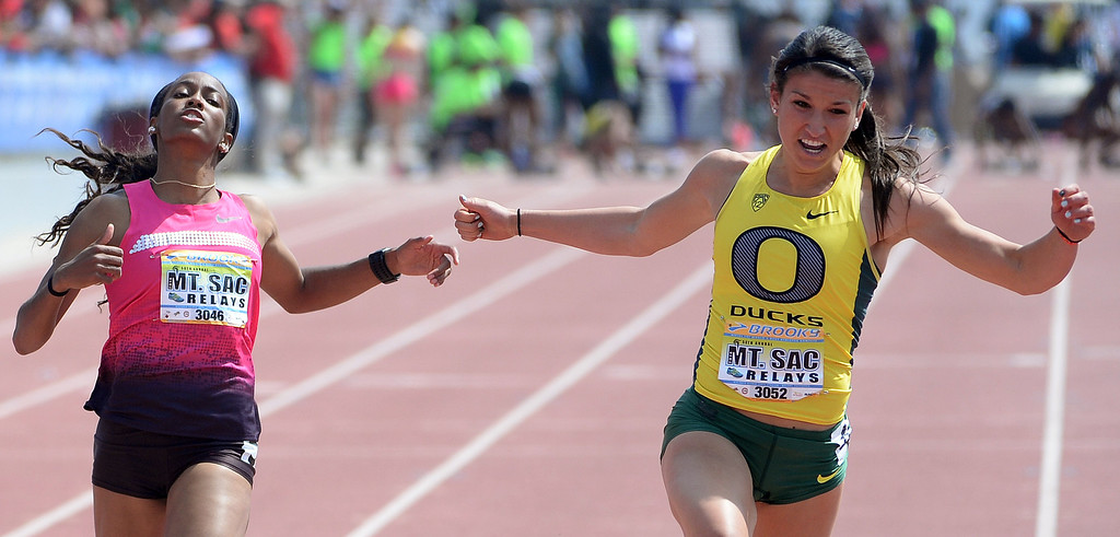. Oregon\'s Jenna Prandini, right, wins the 100 meter Dash Invitational Elite during the Mt. SAC Relays in Hilmer Lodge Stadium on the campus of Mt. San Antonio College in Walnut, Calif., on Saturday, April 19, 2014. 