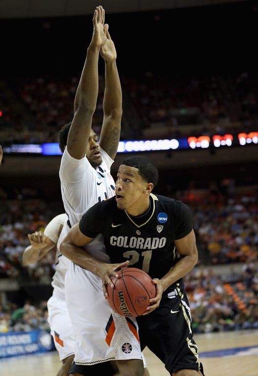 . AUSTIN, TX - MARCH 22:  Andre Roberson #21 of the Colorado Buffaloes dribbles around Myke Henry #20 of the Illinois Fighting Illini during the second round of the 2013 NCAA Men\'s Basketball Tournament at The Frank Erwin Center on March 22, 2013 in Austin, Texas.  (Photo by Ronald Martinez/Getty Images)