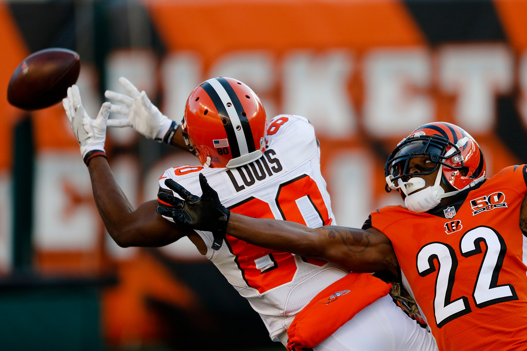 . Cleveland Browns wide receiver Ricardo Louis (80) misses a pass with Cincinnati Bengals cornerback William Jackson (22) in pursuit in the second half of an NFL football game, Sunday, Nov. 26, 2017, in Cincinnati. (AP Photo/Gary Landers)