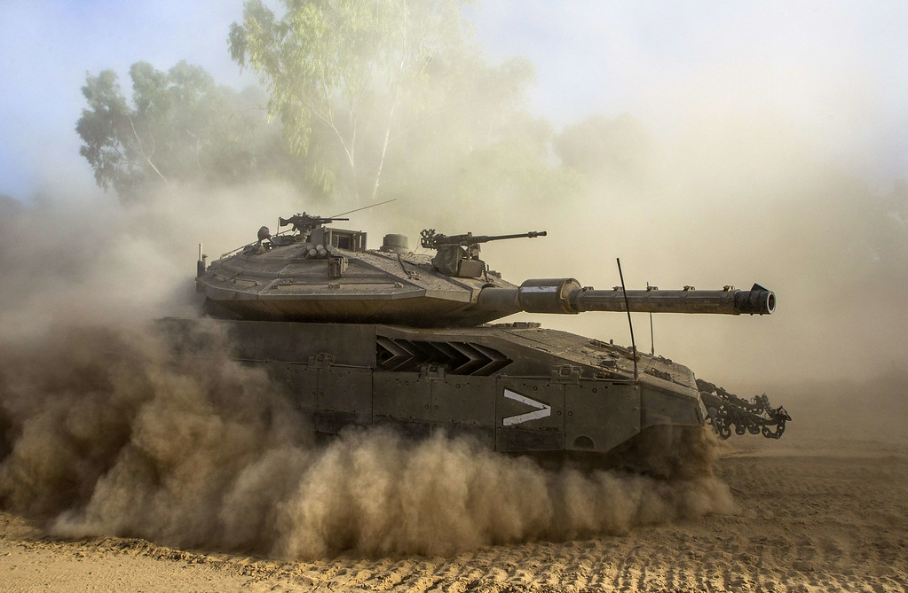 . An Israeli Merkava tank deploys at an army deployment area near Israel\'s border with the Gaza Strip on July 17, 2014. Fighting between Israel and Hamas resumed in deadly earnest today, after a brief humanitarian ceasefire allowed Gaza residents to restock and hunker down, and as efforts towards a lasting truce intensified. AFP PHOTO / JACK GUEZ/AFP/Getty Images