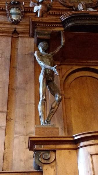 statue on a pedestal in Bologna