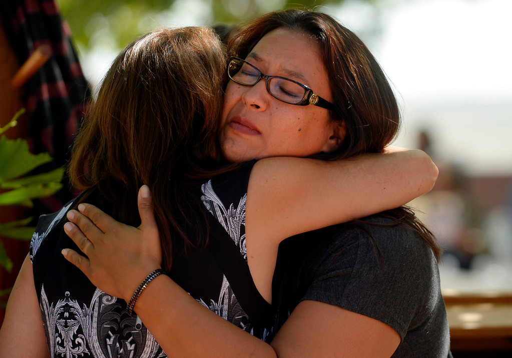 . Jacqui Lopez receives support during a memorial service for Wesley Quinlan and Wiyanna Nelson at the National Center for Atmospheric Research in Boulder, CO September 21, 2013. Lopez is Wiyanna\'s aunt. (Photo By Craig F. Walker / The Denver Post)