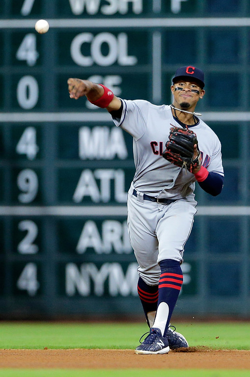 . Cleveland Indians shortstop Francisco Lindor makes the play to first base for the out on Houston Astros designated hitter Yuli Gurriel during the fourth inning of a baseball game Sunday, May 20, 2018, in Houston. (AP Photo/Michael Wyke)
