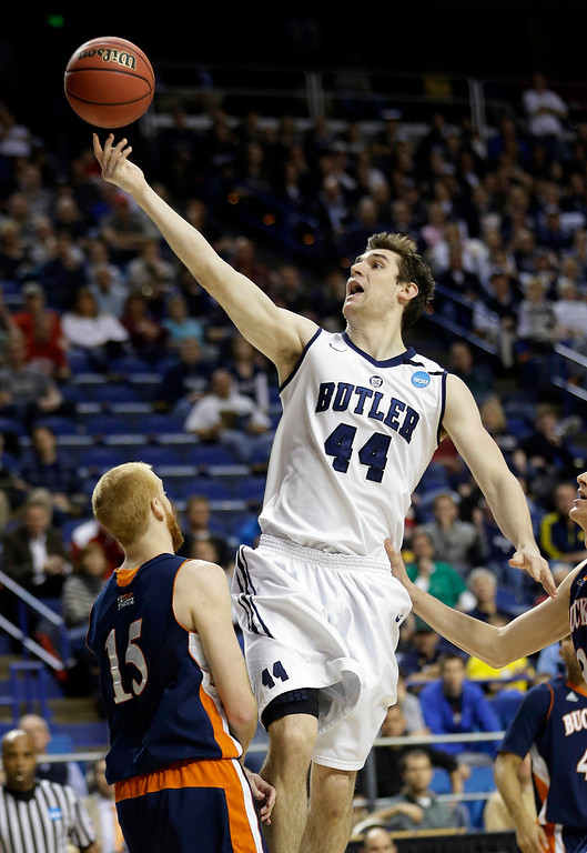 . Butler center Andrew Smith (44) drives into Bucknell forward Joe Willman (15) as he goes up for a shot during the first half  a of their  second round NCAA college basketball tournament game Thursday, March 21, 2013, in Lexington, Ky.  (AP Photo/John Bazemore)