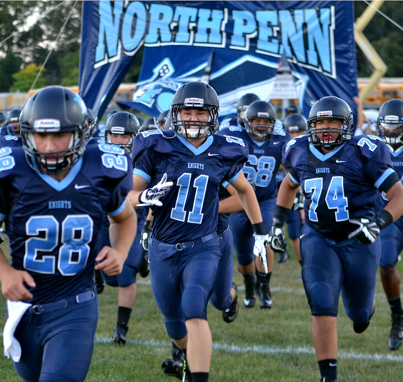 . The North Penn Knights Football team take the field before their contest against  La Salle at North Penn High School on Friday August 29,2014. Photo by Mark C Psoras