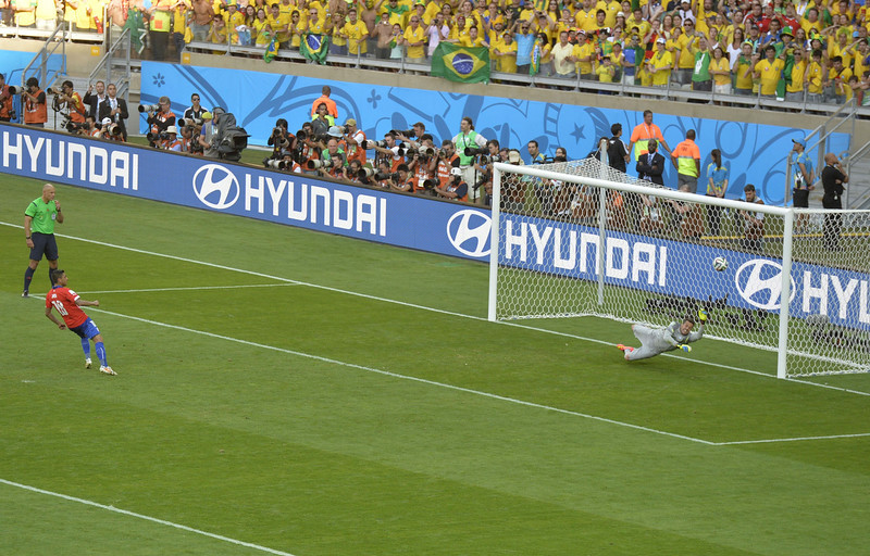 . TChile\'s defender Gonzalo Jara misses the target during the penalty shootout after the extra time in the round of 16 football match between Brazil and Chile at The Mineirao Stadium in Belo Horizonte during the 2014 FIFA World Cup on June 28, 2014. (ODD ANDERSEN/AFP/Getty Images)