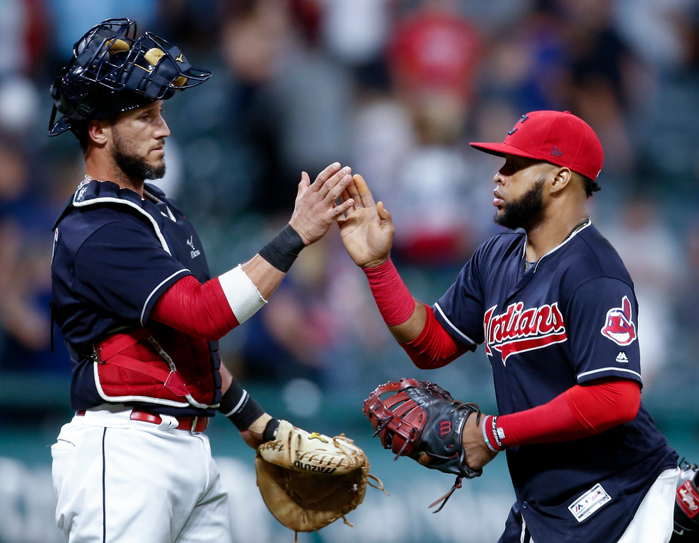 . Cleveland Indians\' Yan Gomes, left, and Carlos Santana celebrate a 4-2 victory over the Minnesota Twins in a baseball game, Wednesday, Sept. 27, 2017, in Cleveland. (AP Photo/Ron Schwane)