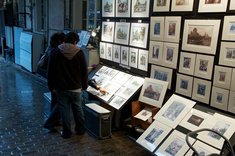 Tourists shopping for art. Ru du Trésor. Quebec City, Canada.
