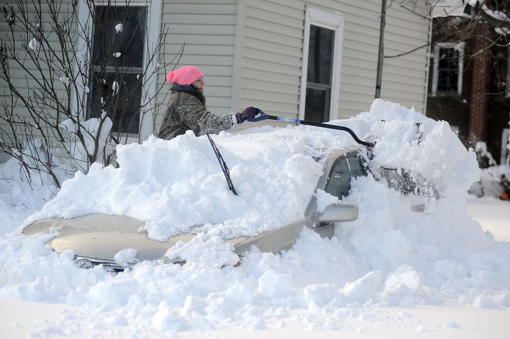 . Abbie J. Haie digs out her grandmother\'s car at their home on Tuesday, Nov. 18, 2014 in  Edwards, N.Y.  A new blast of lake-effect snow pounded Buffalo for a third day piling more misery on a city already buried by an epic, deadly snowfall that could leave some areas with nearly 8 feet of snow on the ground when it\'s all done. (AP Photo/The Watertown Daily Times, Melanie Kimbler Lago)
