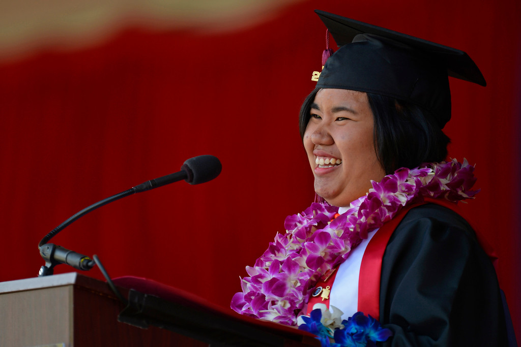 . Valedictorian Justher Gutierrez smiles while giving her speech during the 2014 Saint Mary\'s College commencement ceremony in Moraga, Calif., on Saturday, May 24, 2014. A total of 758 students graduated making this the largest graduating class in school history. (Jose Carlos Fajardo/Bay Area News Group)