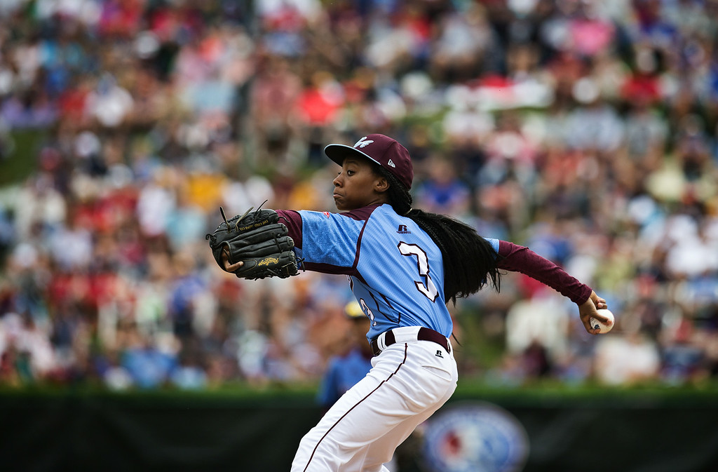 . Philadelphia\'s Mo\'ne Davis delivers a pitch against Nashville in a U.S. pool play baseball game at the Little League World Series, Friday, Aug. 15, 2014, in South Williamsport, Pa. (AP Photo/PennLive.com, Sean Simmers)