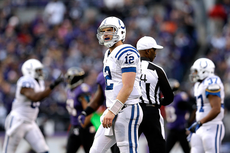 . Andrew Luck #12 of the Indianapolis Colts walks toward the sideline after he threw an incomplete pass on a third down attempt in the fourth quarter against the Baltimore Ravens during the AFC Wild Card Playoff Game at M&T Bank Stadium on January 6, 2013 in Baltimore, Maryland.  (Photo by Rob Carr/Getty Images)