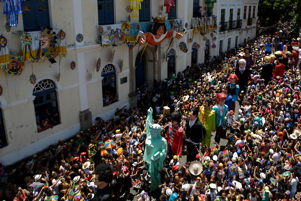 . People parade with giant puppets during Carnival celebrations in Olinda, Pernambuco state, Brazil, Monday, Feb. 27, 2017. (AP Photo/Diego Herculano)