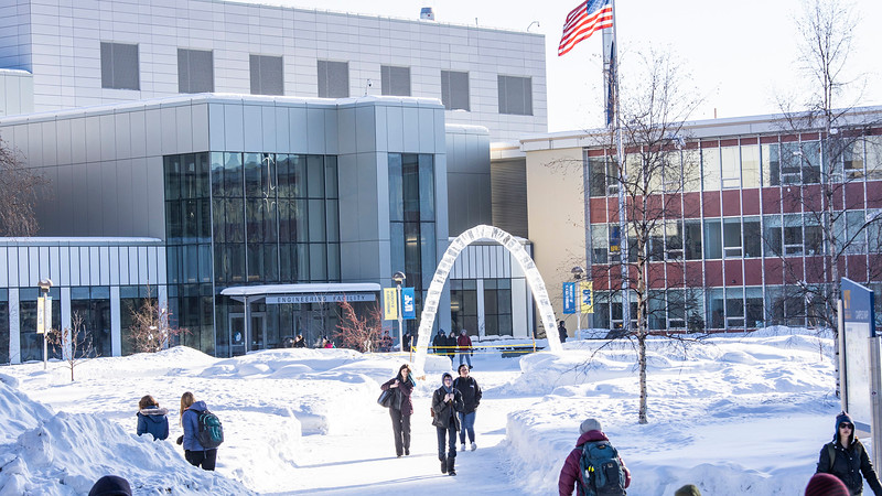 Students walk to class in between classes on a winter afternoon at the Troth Yedha' campus. UAF photo by JR Ancheta.