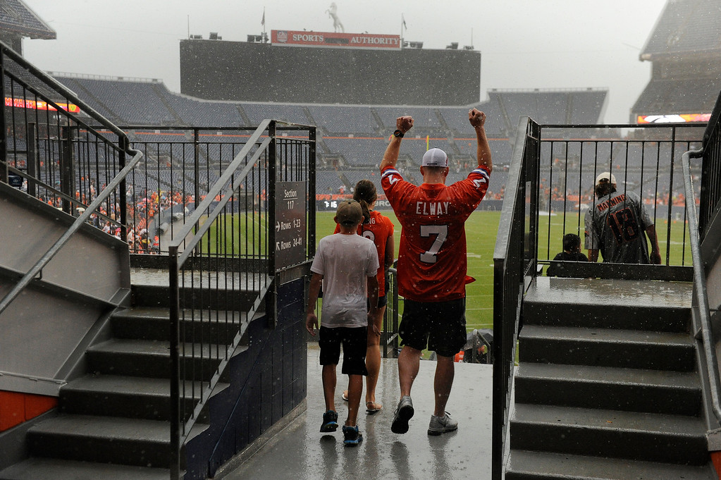 . DENVER, CO. - AUGUST 03: Denver Broncos fans waited inside Sports Authority Field Saturday night, August 3, 2013 hoping the weather would clear so that the team could practice.  Photo By Karl Gehring/The Denver Post