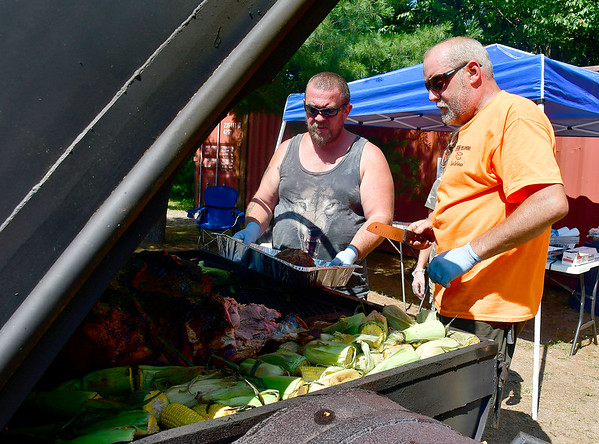 7/13/2019 Mike Orazzi | Staff Ken Clinton and Shaun Prescott while smoking pork during the 29th Annual Pork & Blues Pig Roast at the Swedish Club in Bristol on Saturday.