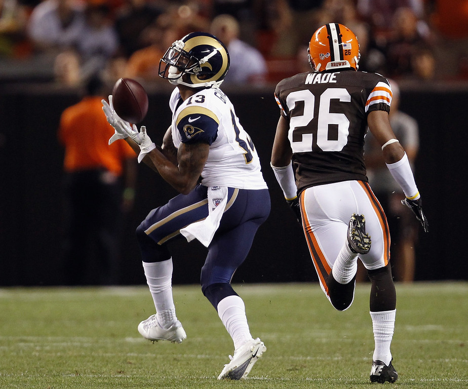 . CLEVELAND, OH - AUGUST 08:  Wide receiver Chris Givens #13 of the St. Louis Rams catches a pass in front of defensive back Trevin Wade #26 of the Cleveland Browns at FirstEnergy Stadium on August 8, 2013 in Cleveland, Ohio.  (Photo by Matt Sullivan/Getty Images)