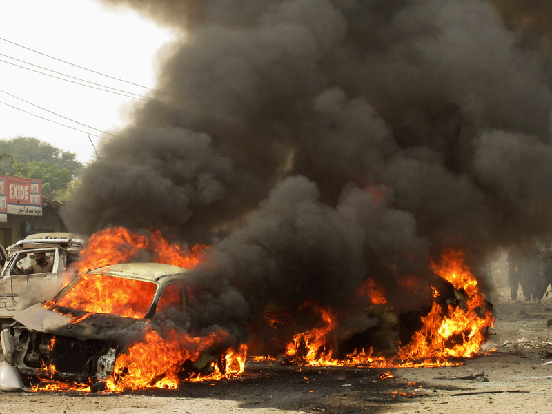 . A car burns after a bomb attack at Fauji Market in Peshawar December 17, 2012. At least 12 people were killed on Monday when the blast struck the market area in Pakistan\'s volatile tribal belt, a security official said. The official said at least 20 people had been wounded in the blast in Fauji Market in the Khyber tribal agency and that the death toll could rise because many were in critical condition. There was no immediate claim of responsibility. REUTERS/Ameerzada Afridi