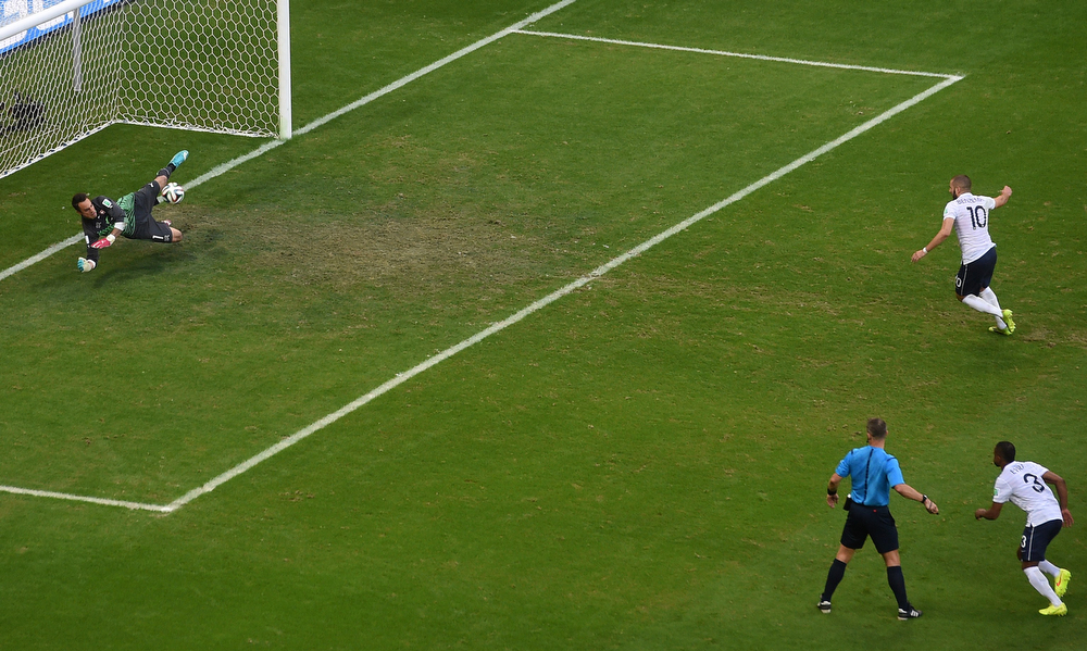 . Switzerland\'s goalkeeper Diego Benaglio (L) saves a penalty shot by France\'s forward Karim Benzema (R) during a Group E football match between Switzerland and France at the Fonte Nova Arena in Salvador during the 2014 FIFA World Cup on June 20, 2014.  (DIMITAR DILKOFF/AFP/Getty Images)