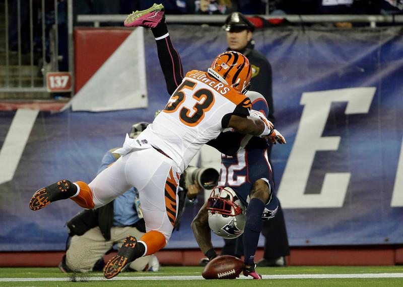 . New England Patriots cornerback Kyle Arrington (25) tumbles into the end zone with a touchdown after recovering a fumble, as Cincinnati Bengals linebacker Marquis Flowers (53) defends in the second half of an NFL football game Sunday, Oct. 5, 2014, in Foxborough, Mass. (AP Photo/Steven Senne)