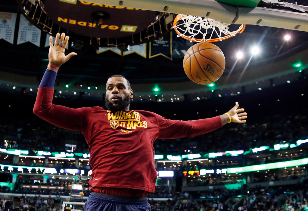 . Cleveland Cavaliers forward LeBron James dunks the ball as he warms up before Game 1 of the NBA basketball Eastern Conference Finals against the Boston Celtics, Sunday, May 13, 2018, in Boston. (AP Photo/Michael Dwyer)
