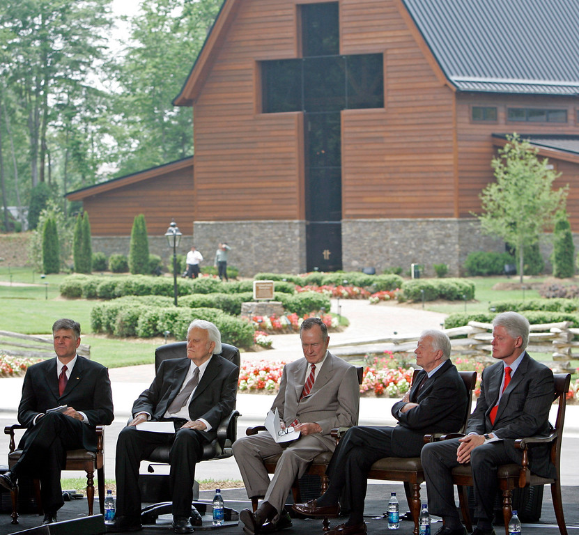 . from left, Franklin Graham and Billy Graham sit with former Presidents George H.W. Bush, Jimmy Carter and Bill Clinton during a dedication ceremony for the Billy Graham Library in Charlotte, N.C., Thursday, May 31, 2007. (AP Photo/Gerry Broome)