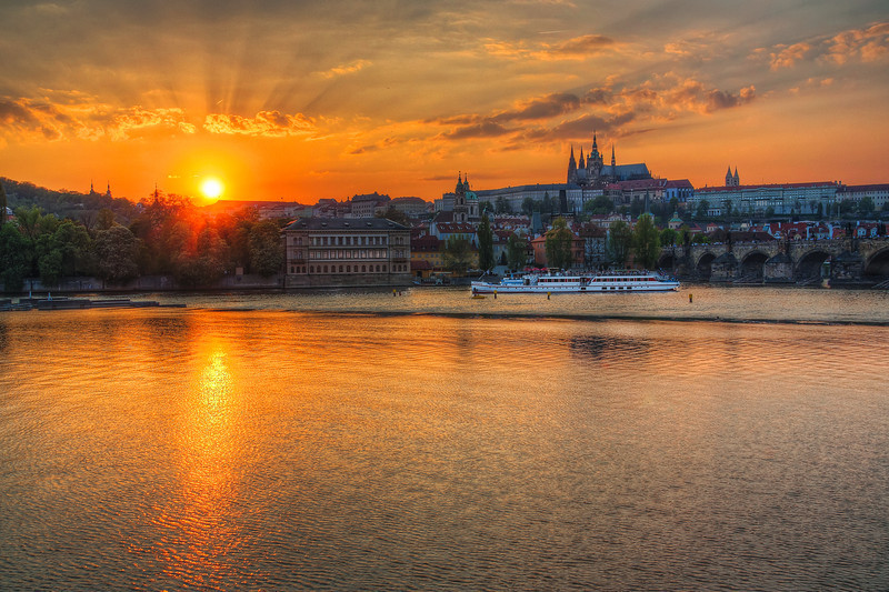 Sun in Prague  Of course when I was in Prague I had to take few sunset shots :) The sunset wasn't exactly how I wanted. It somehow lacked those beautiful sunset colors, but I still tried my best :)  HDR from three shots, taken with Canon 450D with Sigma 18-200 mm lens, from a tripod.