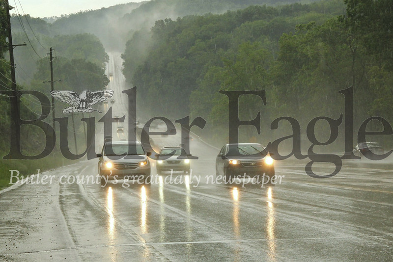 Commuters push through slick conditions on Route 8, South of Butler. Storm systems Tuesday, brought Tornado watches throughout the region. Seb Foltz/Butler Eagle