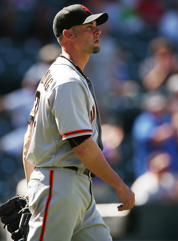 . San Francisco Giants starting pitcher Ryan Vogelsong waits after giving up three-run home run to Colorado Rockies\' Nolan Arenado in the fifth inning of the Rockies\' 9-2 victory in a baseball game in Denver on Wednesday, Sept. 3, 2014. (AP Photo/David Zalubowski)