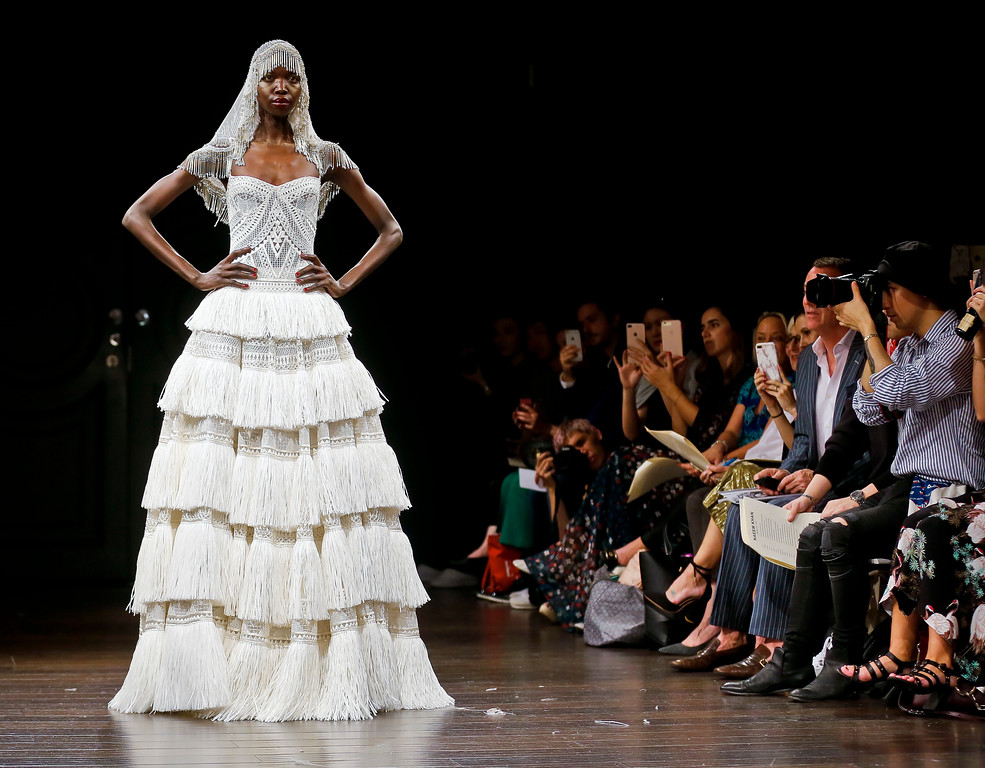 . Bridal fashion from Naeem Khan collection is modeled Oct. 6, 2017, in New York. (AP Photo/Bebeto Matthews)