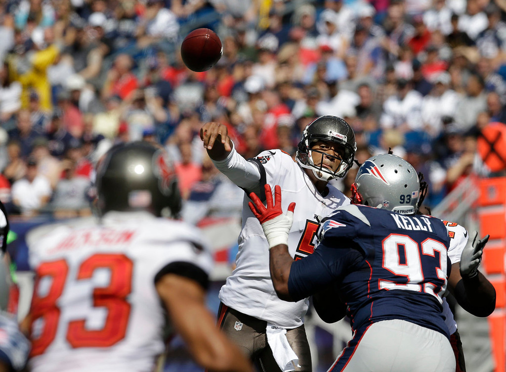 . Tampa Bay Buccaneers quarterback Josh Freeman (5) passes over New England Patriots defensive tackle Tommy Kelly (93) to wide receiver Vincent Jackson (83) in the first half of an NFL football game Sunday, Sept. 22, 2013, in Foxborough, Mass. (AP Photo/Stephan Savoia)