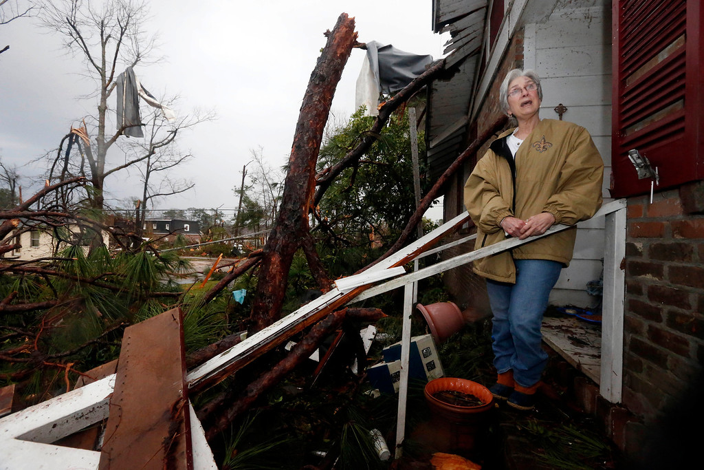 . Marie Key, 68, said she is hoping to salvage what she can Monday morning, Feb. 11, 2013 at her Hattiesburg, Miss., home following Sunday\'s tornado. She was alone in her one-story brick house when the storm hit and dove under a kitchen table, hitting her head. At least three trees hit her house, which she said was also damaged during Hurricane Katrina and another storm in 1998. (AP Photo/Rogelio V. Solis)