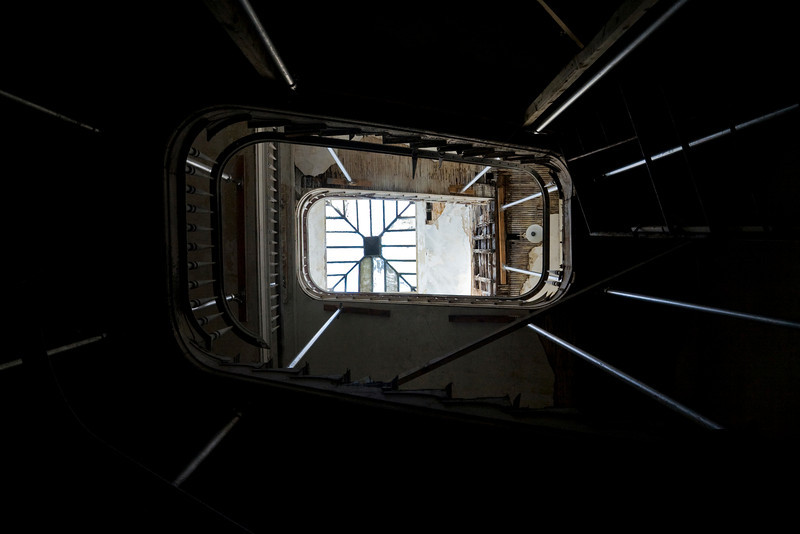 View from ground to skylight up grand stairwell, 1838 main building, Brooklyn Naval Hospital.