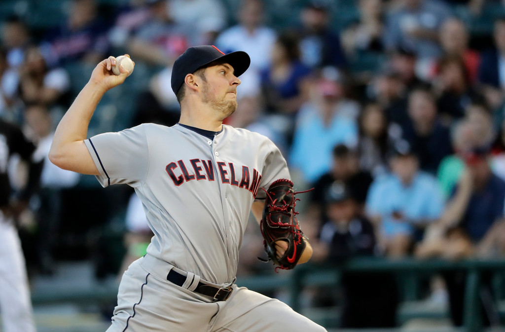 . Cleveland Indians starting pitcher Trevor Bauer delivers during the first inning of the team\'s baseball game against the Chicago White Sox on Wednesday, June 13, 2018, in Chicago. (AP Photo/Charles Rex Arbogast)