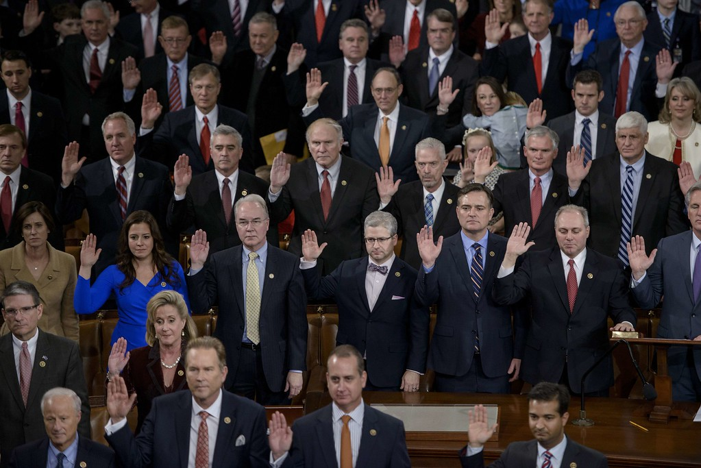 . Members of the House are sworn in during a ceremony in the House of Representatives as the 114th Congress convenes on Capitol Hill January 6, 2015 in Washington, DC.  Republican John Boehner was re-elected and sworn in Tuesday as speaker of the US House of Representatives, overcoming a surprisingly robust attempt to oust him by two dozen hardcore conservatives. Boehner received 216 of the 408 votes cast in the chamber, winning as expected over Democrat leader and former House speaker Nancy Pelosi, who received 164 votes.  BRENDAN SMIALOWSKI/AFP/Getty Images