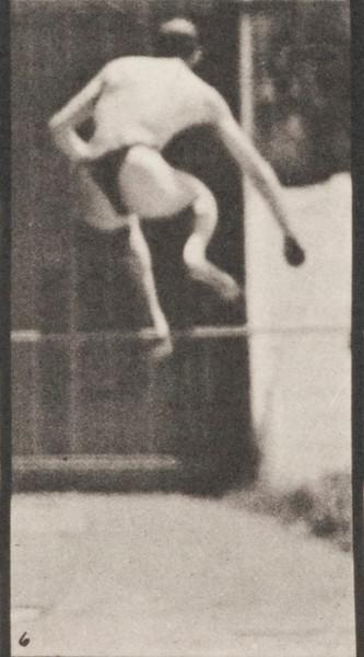 Man in pelvis cloth jumping horizontal bar