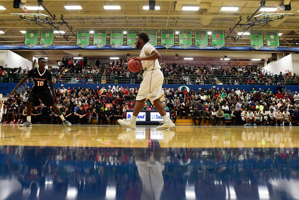 . Reggie Gibson (1) of Overland brings the ball up court against EagleCrest during the first half of play. The Overland Trailblazers hosted the Eaglecrest Raptors on Friday, January 8, 2016. (Photo by AAron Ontiveroz/The Denver Post)