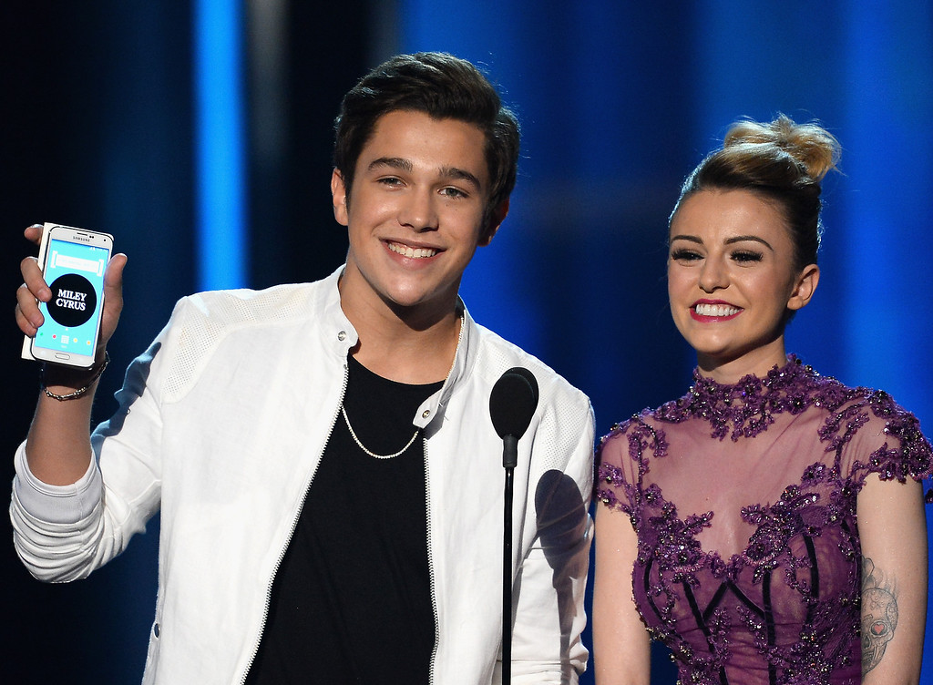 . Recording artists Austin Mahone (L) and Cher Lloyd speak onstage during the 2014 Billboard Music Awards at the MGM Grand Garden Arena on May 18, 2014 in Las Vegas, Nevada.  (Photo by Ethan Miller/Getty Images)